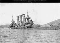 The Russian pre-dreadnought battleship Retvizan sunk at Port Arthur as a result of bombardment by Japanese land based artillery